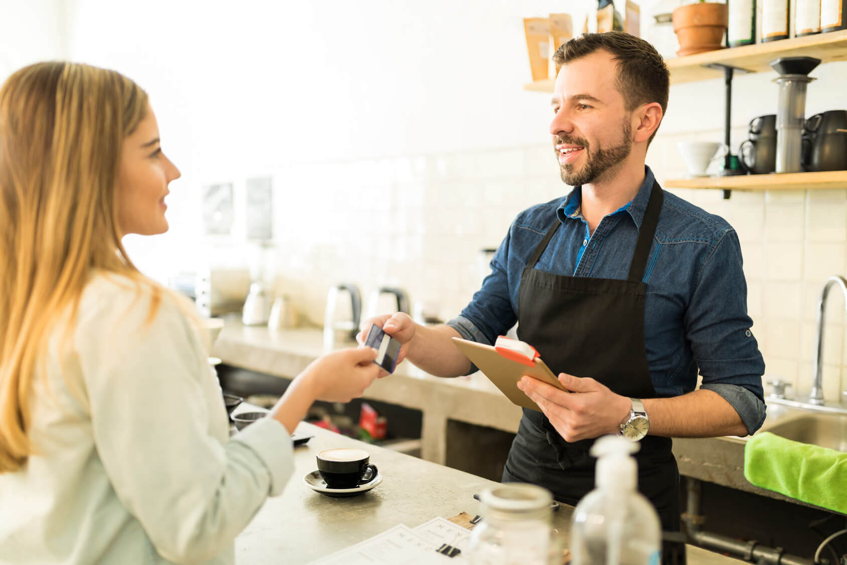 Friendly business owner with customer